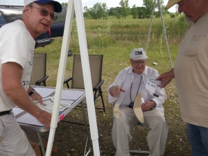 Bob Warmann in the foreground resting after winning Cat. Glider with a 3 1/2 minute flight.