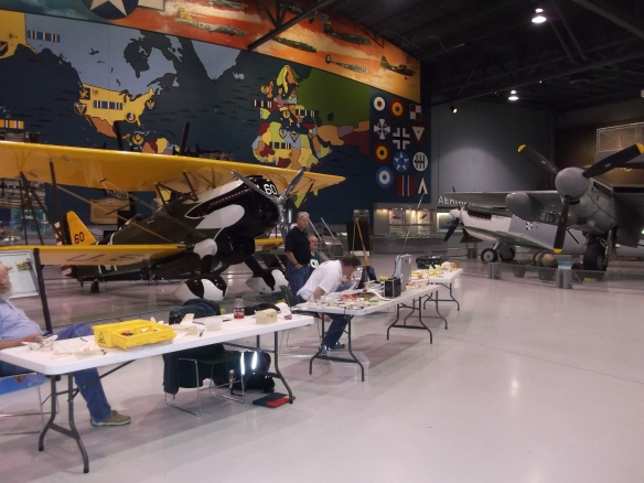 HG Frautschy with a table of displayed models in the great EAA venue.